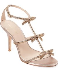 Pelle Moda - Platinum Gold Kiss Embellished Bow High Heel Sandals - Lyst