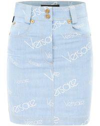 Versace - All Over Logo Print Denim Skirt - Lyst