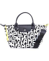 3b96115e97 Longchamp 'le Pliage' Optical Print Nylon Bag - Lyst