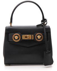 7ee694752f Versace Pebbled Leather Top-handle Tote Bag in Black - Lyst