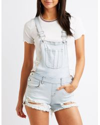 d98b20e90a1 Lyst - Charlotte Russe Destroyed Denim Overalls in Black