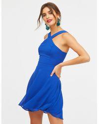 8b7951f8857e Lyst - Charlotte Russe Floral Bib Neck Skater Dress in Orange