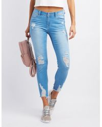 Charlotte Russe - Destroyed Push-up Skinny Jeans - Lyst