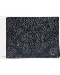 COACH - Slim Billfold Wallet In Signature Coated Canvas - Lyst