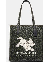 cd9aaf0d245 Lyst - COACH Disney X Market Tote With Spooky Eyes Print in Green