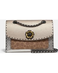 09035bcfa7c6f COACH - Parker With Border Rivets And Snakeskin Detail - Lyst