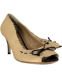 092964d9231 Lyst - Fendi Sta Woven Straw Peep Toe Slingback Platform Pumps in Black