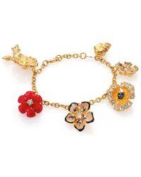 Alexander McQueen Mixed Flower Charm Bracelet gold - Lyst