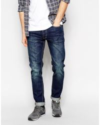 Bellfield Washed Indigo Jeans In Tapered Fit - Lyst