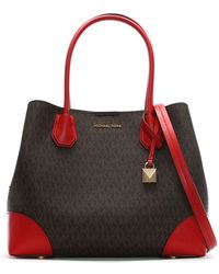 8015f4db80 Michael Kors - Annie Medium Brown   Bright Red Coated Canvas Logo Tote Bag  - Lyst