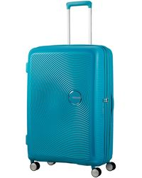 American Tourister - Curio 69cm Spinner - Lyst