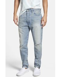 Levi's '501' Tapered Fit Jeans - Lyst