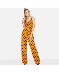 290bee3866f Girls On Film - Orange Domino Jumpsuit In Polka Dot - Lyst