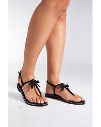 Quiz - Black Bow Diamante Edge Flat Sandals - Lyst
