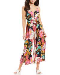 6829675336c Lyst - Billabong Twist N Shout Floral Printed Tie Front Jumpsuit