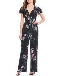 June & Hudson - Flutter-sleeve Floral-printed Jumpsuit - Lyst