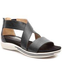 f0a1fdaf371b Lyst - Women s Adrienne Vittadini Flat sandals On Sale