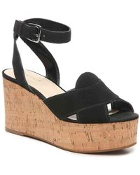 a98a12aa044c Lyst - Nine West Moveover Peep Toe Wedges in Black
