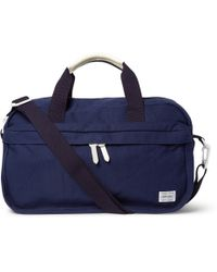 Porter Yoshida & Co Beat Leather-trimmed Canvas Boston Bag - Lyst