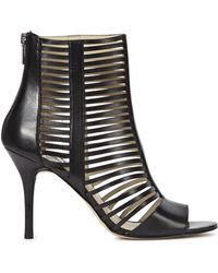 e7271a944b5e Michael Kors - Odelia Black Caged Leather Sandals - Lyst