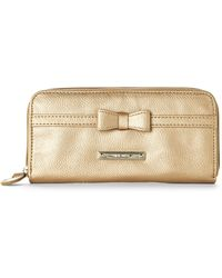 Nine West Shimmer Gold Tie A Bow Wallet - Lyst