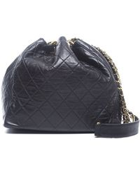 Chanel Preowned Black Lambskin Vintage Drawstring Bag - Lyst