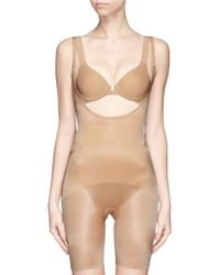 Spanx Skinny Britches® Open-Bust Mid-Thigh Body beige - Lyst