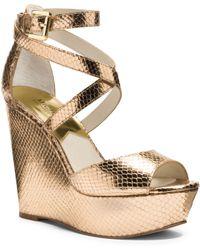 Michael Kors Gabriela Metallic Embossed-Leather Wedge gold - Lyst
