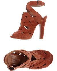 Alaïa Sandals orange - Lyst