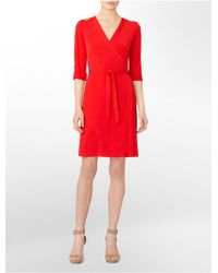 Calvin Klein Roll-up Long Sleeve Wrap Dress - Lyst