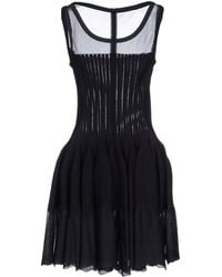 Alaïa Short Dress black - Lyst