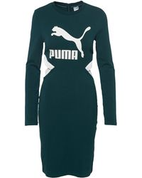 a1e4828a1f PUMA Quilted Hooded Sweatshirt Dress in Black - Lyst