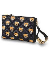 Moschino Clutches - Lyst