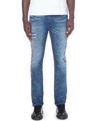 Diesel Thavar Slim-fit Skinny Mid-rise Stretch-denim Jeans Blue - Lyst