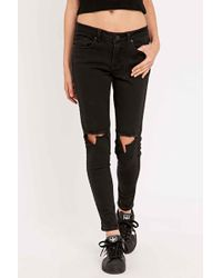 UNIF - Burn Low-rise Black Ripped Skinny Jean - Lyst