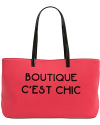 Boutique Moschino - Shopping In Neoprene Con Lettering Gommato - Lyst