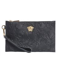 Versace - Leather Pouch With Embossed Flowers - Lyst