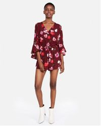 Express - Floral Surplice Bell Sleeve Romper - Lyst