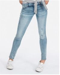 Express - Low Rise Ripped Extreme Stretch Jeggings, Women's Size:00 Short - Lyst