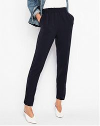 Express - Mid Rise Ruffle Waist Pull-on Pant - Lyst