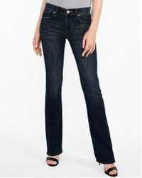 Express - Mid Rise Dark Wash Stretch Barely Boot Jeans, Women's Size:00 Short - Lyst