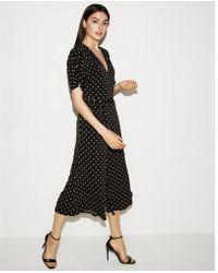 Express - Polka Dot Knit Culotte Tie Waist Jumpsuit - Lyst