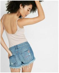 Express - Low-rise Embroidered Broken Heart Cutoff Shorts - Lyst