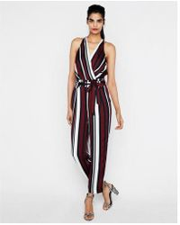 Express - Striped Belted Surplice Jumpsuit - Lyst