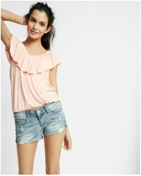 Express - Low Rise Relaxed Destroyed Stretch+ Denim Shorts - Lyst