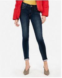 Express - Petite Mid Rise Dark Wash Fleece Stretch Jeggings, Women's Size:00 Petite - Lyst