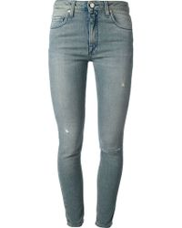 Victoria Beckham Distressed Skinny Jeans - Lyst