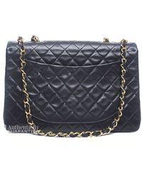Chanel Preowned Black Lambskin Maxi Single Flap Bag - Lyst