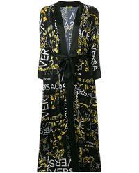 f217bd315035 À découvrir   Manteaux Versace Jeans femme à partir de 154 €