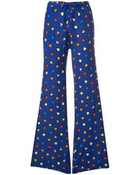 Love Moschino | Heart Print Flared Trousers | Lyst